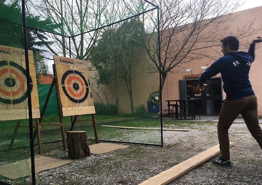 axe throwing team building outdoors